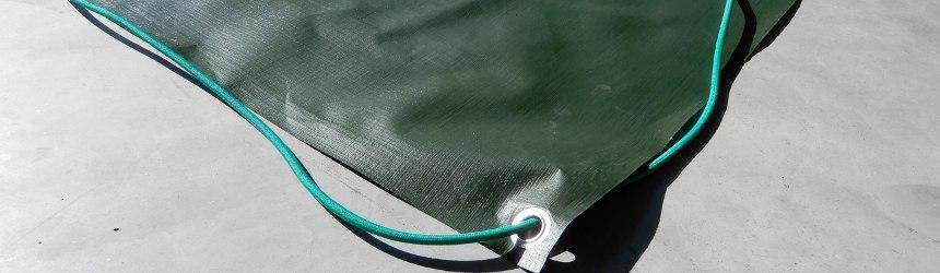 coperture invernali con borchie ed elastico per piscine interrate
